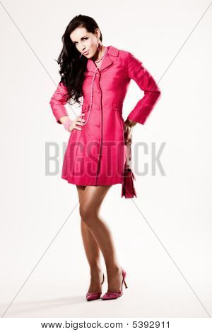Attractive Young Fashion Model In Pink Coat