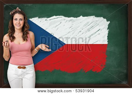 Beautiful And Smiling Woman Showing Flag Of Czech Republic On Blackboard