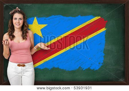 Beautiful And Smiling Woman Showing Flag Of Democratic Republic Of The Congo On Blackboard