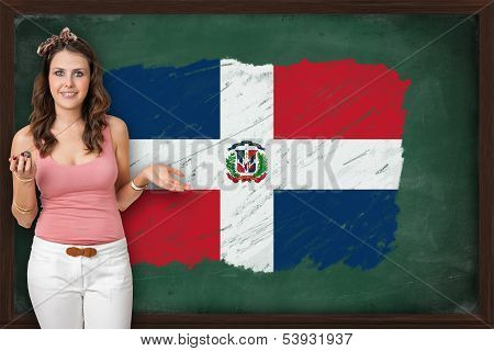 Beautiful And Smiling Woman Showing Flag Of The Dominican Republicon Blackboard