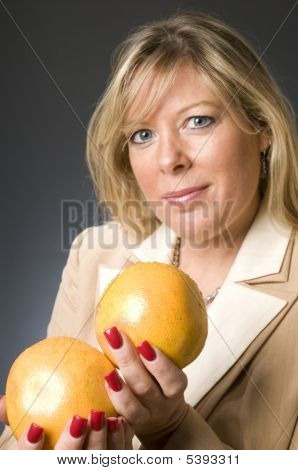 Woman With Bowl Of Fruit