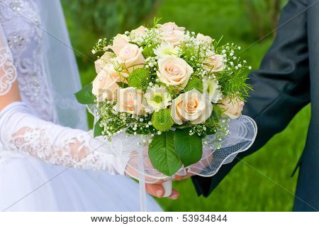 Wedding Theme, Hands And Rings On Wedding Bouquet
