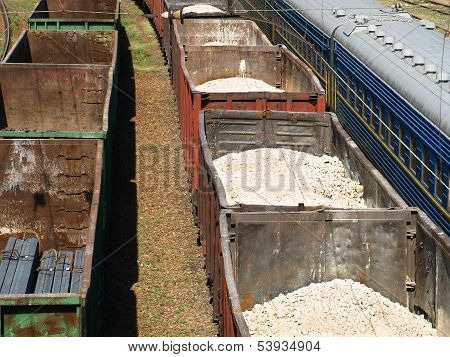 Freight Trains Of Sulfur And Metal Profile.