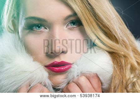 Pretty blonde woman in a warm winter coat