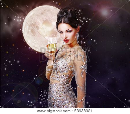 Gorgeous Woman With A Glass Of Champagne On The Background Of A Starry Night.