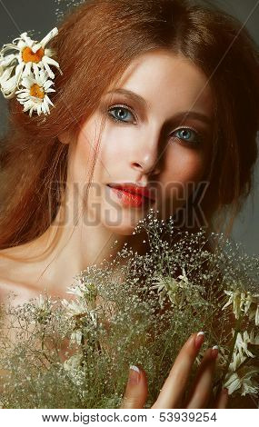 Pure Beauty. Auburn Girl Holding Bouquet Of Wildflowers. Tenderness