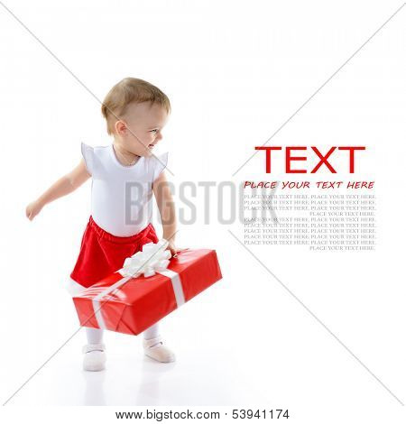 Holidays, baby girl make a present, christmas, birthday, new year, x-mas concept - happy child girl with gift boxes