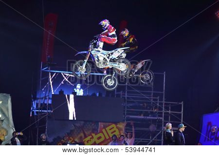 MOSCOW - MAR 02: Doubles jump motorcyclists on the festival extreme sports Breakthrough 2013 in the arena of the Olympic Sports Complex, on March 02, 2013 in Moscow, Russia.