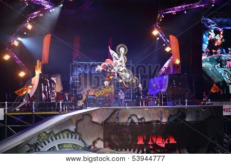 MOSCOW - MAR 02: Simultaneous somersault motorcyclists on the festival extreme sports Breakthrough 2013 in the arena of the Sports Complex, on March 02, 2013 in Moscow, Russia.