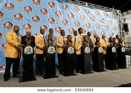 CANTON, OH-AUG 3: The NFL Class of 2013 stand with their busts during the 2013 Enshrinement Ceremony at Fawcett Stadium on August 3, 2013 in Canton, Ohio.