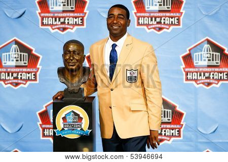 CANTON, OH-AUG 3: Former Minnesota Vikings receiver Cris Carter poses with his bust during the NFL Class of 2013 Enshrinement Ceremony at Fawcett Stadium on August 3, 2013 in Canton, Ohio.