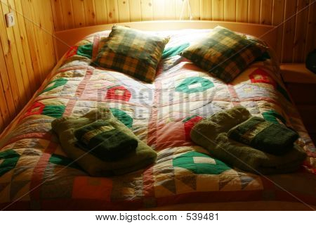 Colorful Bed Linen On A Wooden Bed