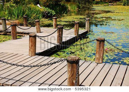 Wooden Dock On Garden Pond
