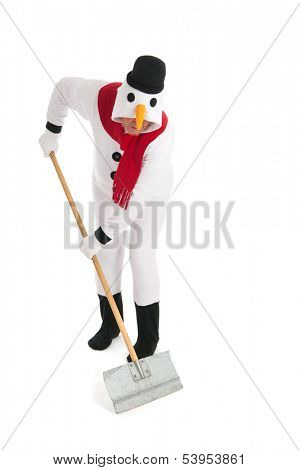 Human snowman is cleaning the street from snow