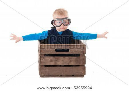 Young Boy Pilot Flying A Wood Box