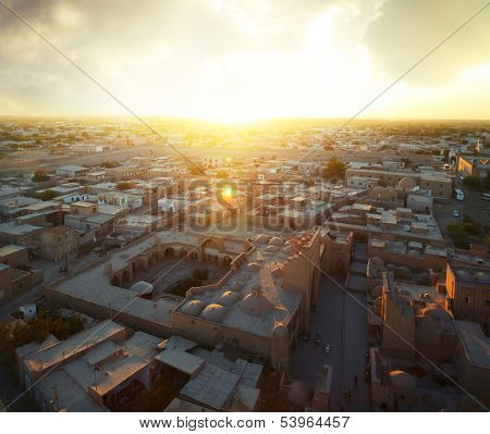 Ancient city of Khiva at sunset. Aerial view from top of a minaret