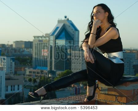 Sitting Girl At City Background