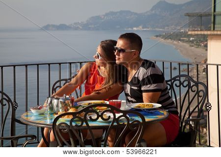 Young Couple Having Breakfast On Hotel