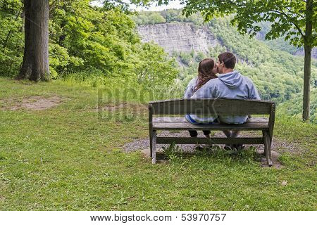Young Couple Kissing In The Park