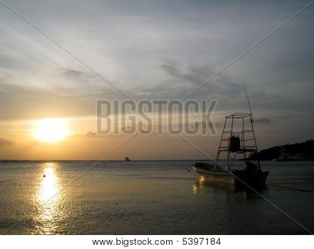 Boat At Sunset In Roatan