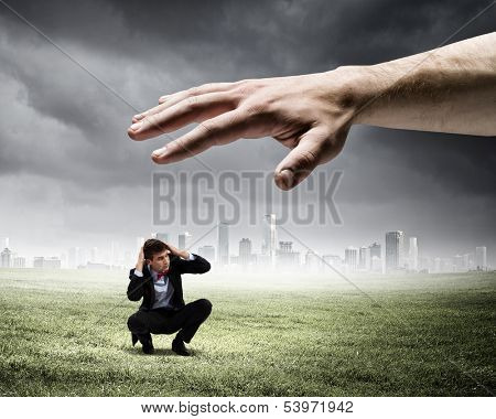 Big human hand catching businessman. Professional relations