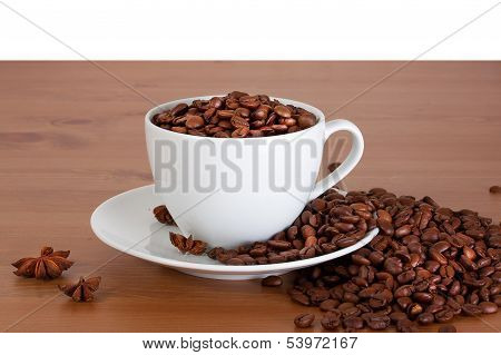 Cup with coffee beans