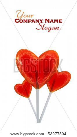 A trio of heart shaped red lollipops
