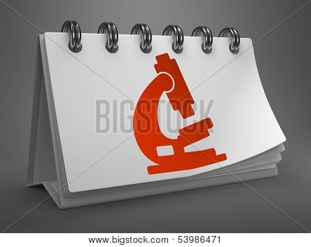 Desktop Calendar with Microscope Icon.