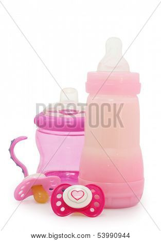 pink dummies and bottles on white