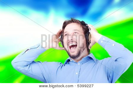 Happy Man Listening To Music With Headset On