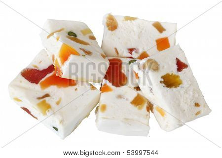 Nougat with dried fruits isolated on white background