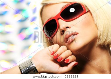Blond Woman In Red Sunglasses