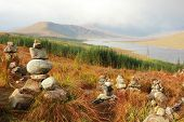 Love sanctuary with stones stacks and  love inscription with mountains in background, in Highlands,