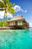 image of beach hut  - Over water bungalow with steps into amazing lagoon - JPG
