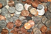 stock photo of greedy  - Background of Different Types of American Coins - JPG