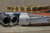 pic of shotgun  - vintage hunting gun with cartridges on wooden background
