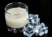 foto of bailey  - Baileys liqueur in glass isolated on black - JPG