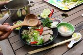 picture of rice noodles  - Preparing Pho Vietnamese rice noodles with beef - JPG