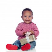 stock photo of biracial  - Adorable African American child playing with a gift box isolated on a white background - JPG