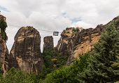 pic of suspenders  - Cable car between monasteries at Meteora meaning middle of the sky suspended in the air or in the heavens above is one of the largest and most important complexes of Eastern Orthodox monasteries in Greece - JPG