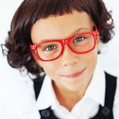 image of  preteen girls  - Portrait of funny little school girl wearing glasses - JPG