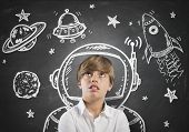 stock photo of surrealism  - Child who dreams of being in space with open eyes - JPG