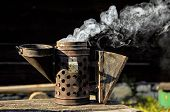 stock photo of smoker  - Antique bee smoker - JPG
