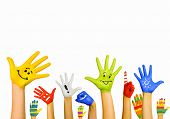 image of child development  - Image of human hands in colorful paint with smiles - JPG
