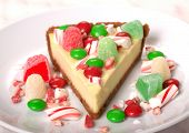 image of cheesecake  - Delicious Festive Christmas Cheesecake with assorted candies - JPG