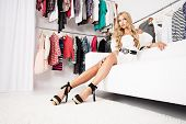 pic of boutique  - Fashionable young woman shopping in a clothing store - JPG
