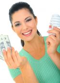 stock photo of holding money  - save energy concept - JPG