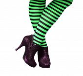 image of stocking-foot  - Green and Black striped stockings on witch legs with black spiky high heels - JPG
