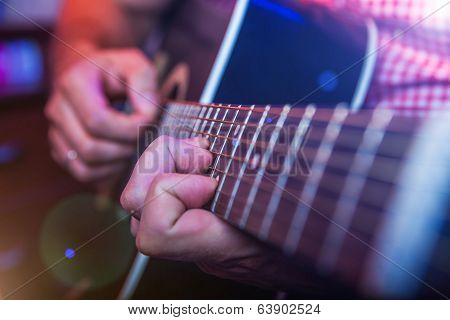 Male Musician With A Acoustic Guitar