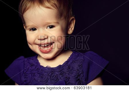 Beautiful Happy Little Girl In A Purple Dress
